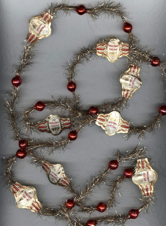 Antique feather tree tinsel garland with merry christmas cigar