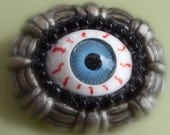 The eye is easily frightened - Pin Brooch - Bloodshot BLUE Eyeball