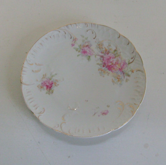 Antique plate embossed pink roses and scrollwork