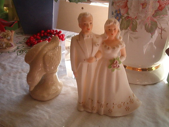 Beautiful Porcelain Figurine of a Bride and Groom Mostly all white with gold detail and pink roses Marked F-632