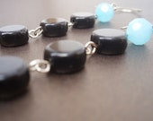 The Moon was Blue earrings - Faceted blue rounds and black discs