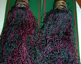 Two Burgandy and Green Tassels with a 6 foot twisted cord with tassels