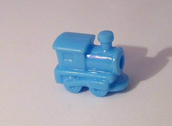 8 Cute little plastic train beads