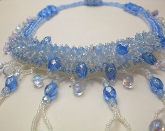 Beadwoven Crystal Necklace  Blue white  Iridescent Ocean Waves