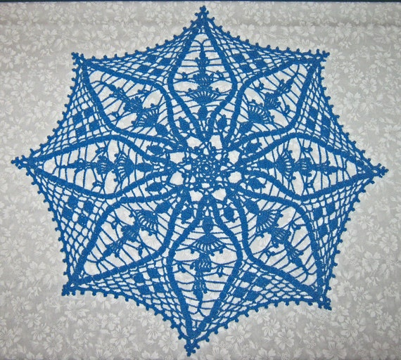 "19 inch  Hawaiian Blue Doily, the name of the design is ""Suncatcher""."