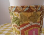 Be eco friendly at the coffee shop with a reusable coffee sleeve