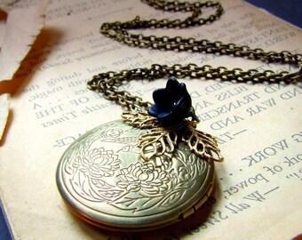 Antiqued brass floral locket necklace with black tulip, floral etched, round locket, filigree leaves, photo locket