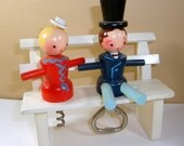Vintage Corkscrew Bottle Opener / Barware / Man Woman Wood Figures On Bench  (298-12)