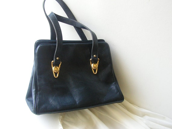 Luxurious vintage 50s genuine leather  forest green  hand bag. Made by Croskopf''s.