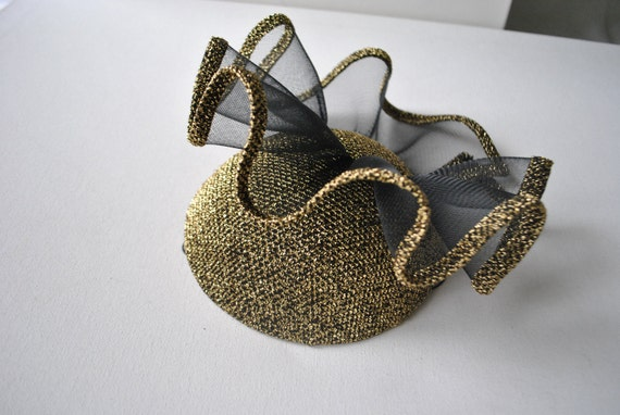 Reserved for  Nan.  Runway vintage 80s goldtone metallic fascinator hat with large black ruffled  bow.  Made by Chapeau Creations.