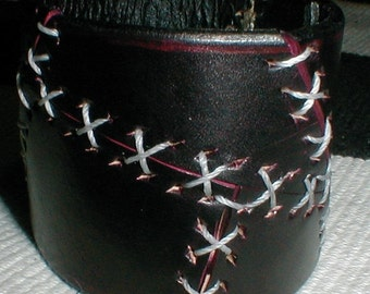 black and white stitched leather cuff