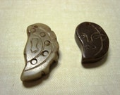 two carved serpentine pendants
