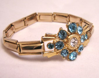 Vintage Expansion Bracelet with Blue Rhinestone Flower Centerpiece. J136