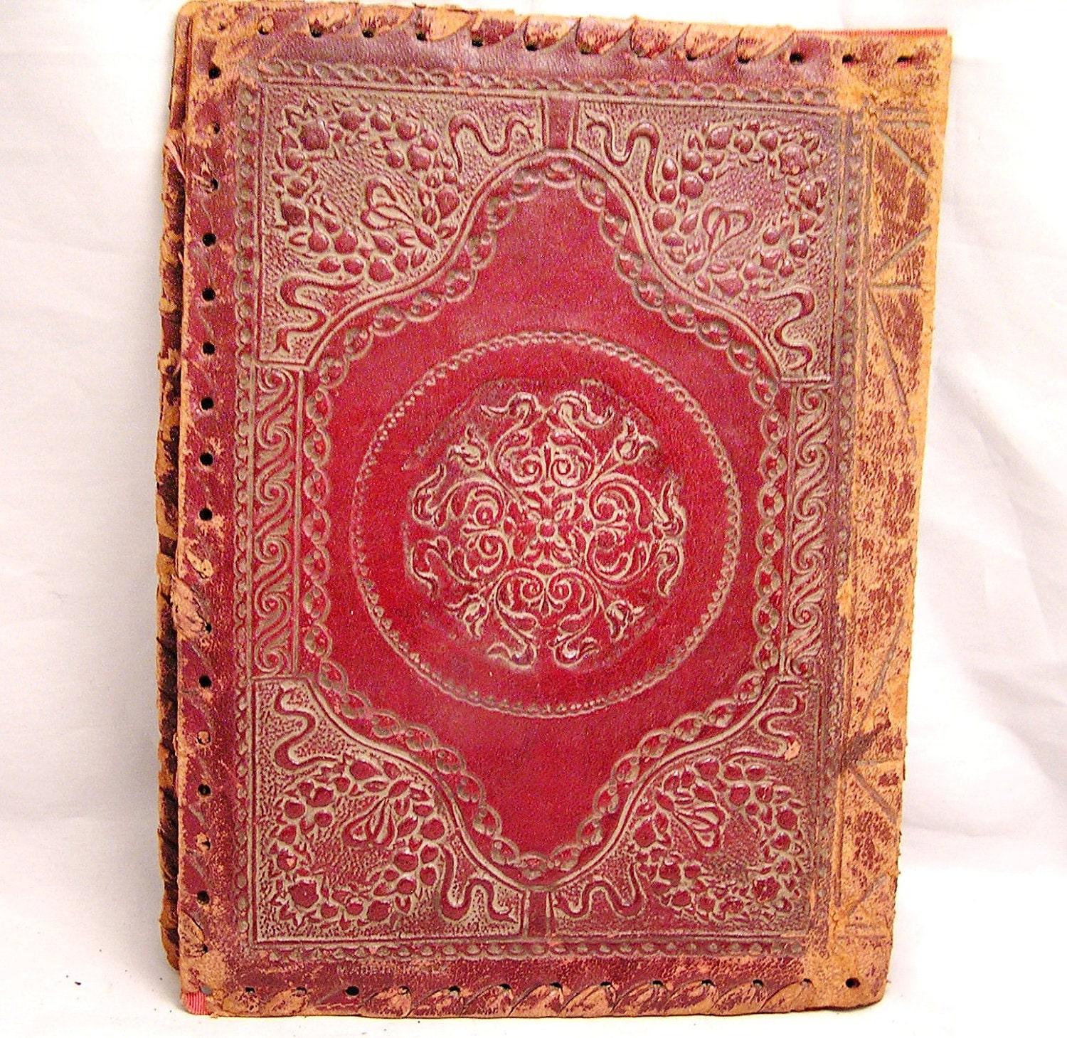 Embossing Fabric Book Cover : Antique embossed leather book cover with lion