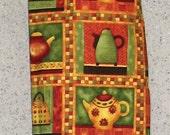 Teapots on Green and Burnt Orange Plastic Bag Holder / Dispenser