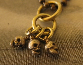 ITSY BITSY SKULLS bronze on long antiqued brass ball chain