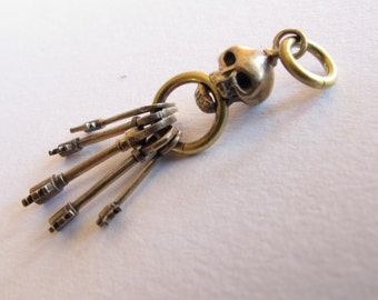 Skull key ring with sterling french wires and extra skull to match for pendant