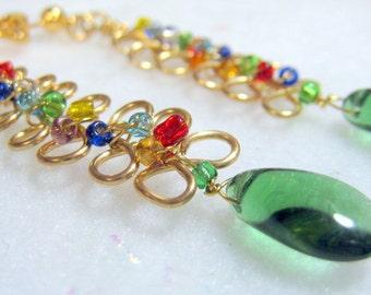 Infinity Wirewrapped Gold Earrings with Green Teardrops