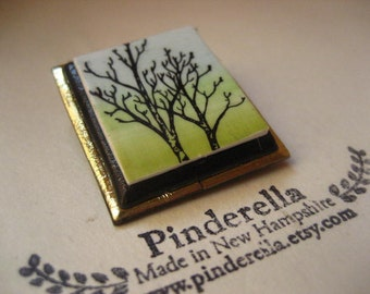 Tree silhouette pin in black and muted pastels
