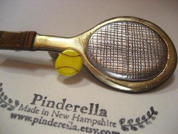 Tennis racquet and tennis ball pin
