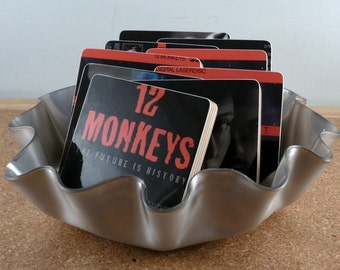 12 MONKEYS recycled movie cover coasters with warped laserdisc basket