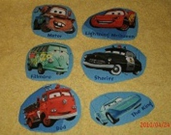 Cars , Lighting McQueen, Mater, Sheriff, Red, The King, andFillmore