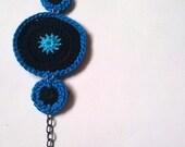 blue and black crochet bracelet