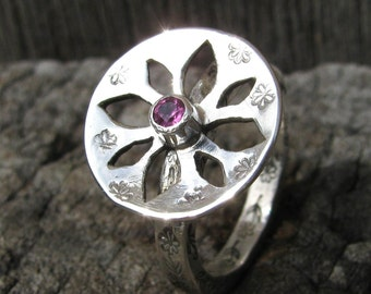 Daisy ring with a difference and a amerhyst set into the ring.