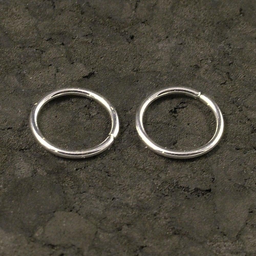 tiny silver hoop earrings cartilage tragus helix. Black Bedroom Furniture Sets. Home Design Ideas