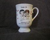 1972 Love is . . . Admitting His Coffee Tastes Better Than Yours Coffee Cup