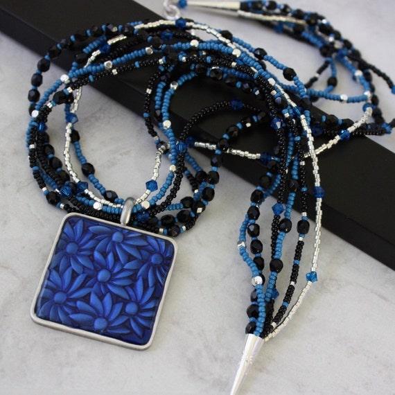 Jet Czech Glass Multi Strand Necklace with Blue Flower Pendant