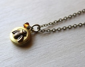 Petite Bumble Bee. Topaz Honey Wire wrapped topaz Swarovski Crystal and Small Brass Locket
