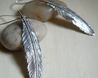 flight. earrings. silver