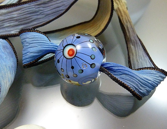 "Melanie Moertel Lampwork Beads - Round blue glass focal bead with satellites, strung on a hand dyed silk ribbon - ""Space Ball"""