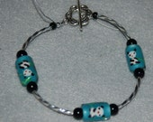 Pandas Please - Adorable Panda Bear Bracelet with Light Turquoise Lampwork Pandas, Sterling Silver Twist Tubes, Black Beads and Sterling Toggle Clasp