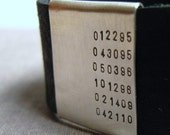 Leather and sterling silver cuff (NUMBERS)