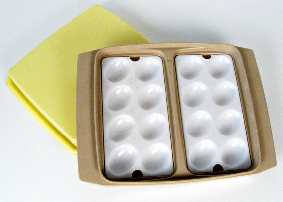 vintage Tupperware tan deviled egg carrier with yellow lid
