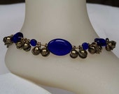 Cobalt blue oval ankle bells, oxidized gold tone