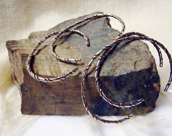 A Pair of Handmade Two Tone Nickel and Copper Bangle Bracelets