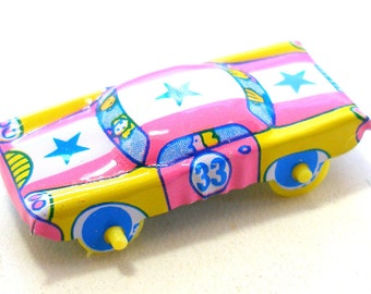 Tin toy car, Pink with yellow, blue & star, Number 33. Tin lithograph.