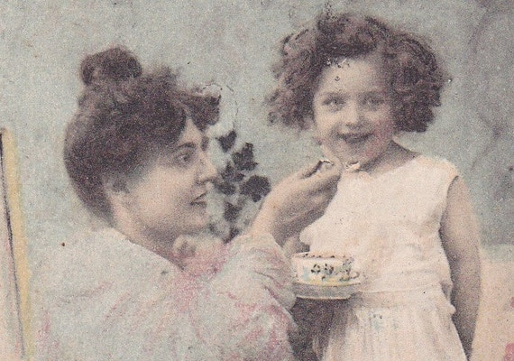 SALE 1900s French postcard, Lady feeding daughter, paper ephemera. Price reduced.