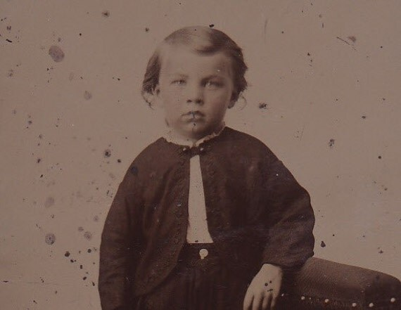 1800s Victorian tintype portrait of a young boy, ferrotype photograph.