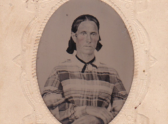Victorian tintype portrait of an older lady, ferrotype photograph.