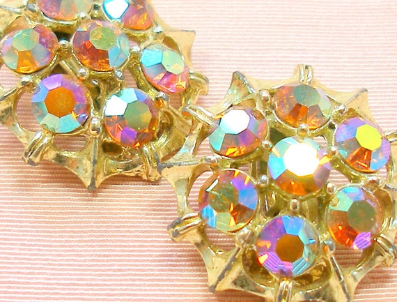 60s Rhinestone earrings, Vintage Aurora Borealis in gold setting, clip on.