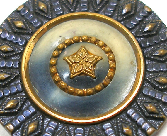 Victorian STAR button, Large antique brass & celluloid with navy tinting.