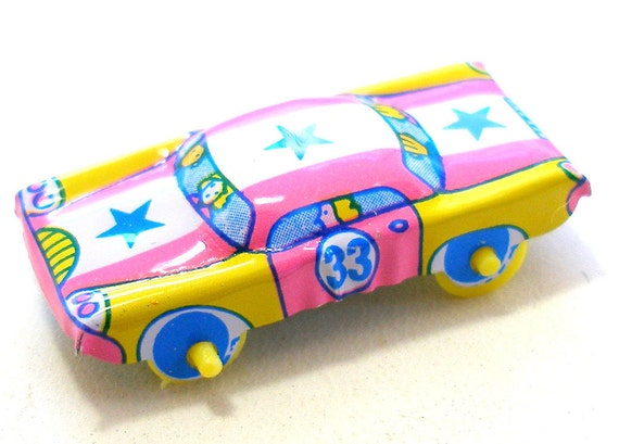 Tin toy car, Pink with yellow, blue & star, Number 33.