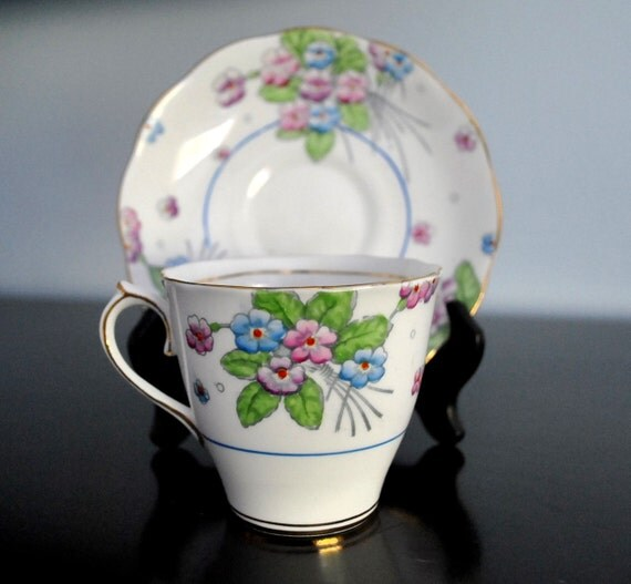 LOVELY ROYAL ALBERT BLUE AND LILAC FLORAL CUP AND SAUCER