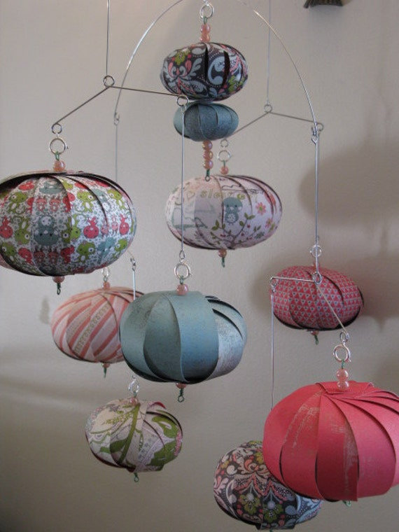 Fun pinks, greens, stripes, bunnies in a whimsical hanging mobile.