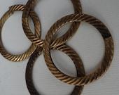 Vintage brass hoop/loop. Have great weave/design.