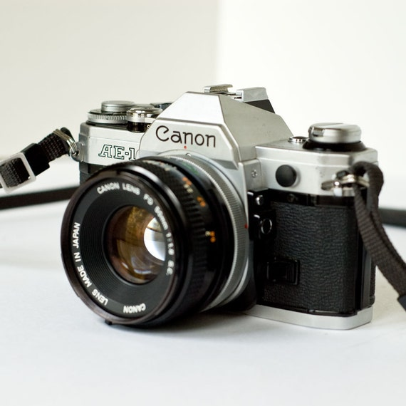 1980s Canon AE-1 35mm SLR camera with 50mm f1.8 lens